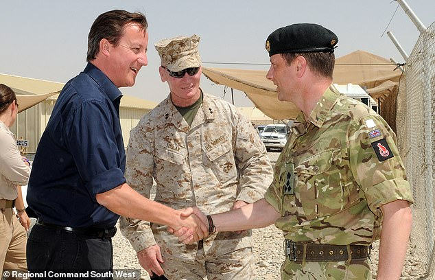 The 57-year-old, pictured in Afghanistan with then-Prime Minister David Cameron, had denied fraud
