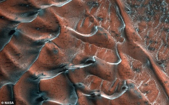 NASA has released a new image, taken by the Mars Reconnaissance Orbiter, of stunning icy sand dunes within a 3-mile crater on the planet's northern planes