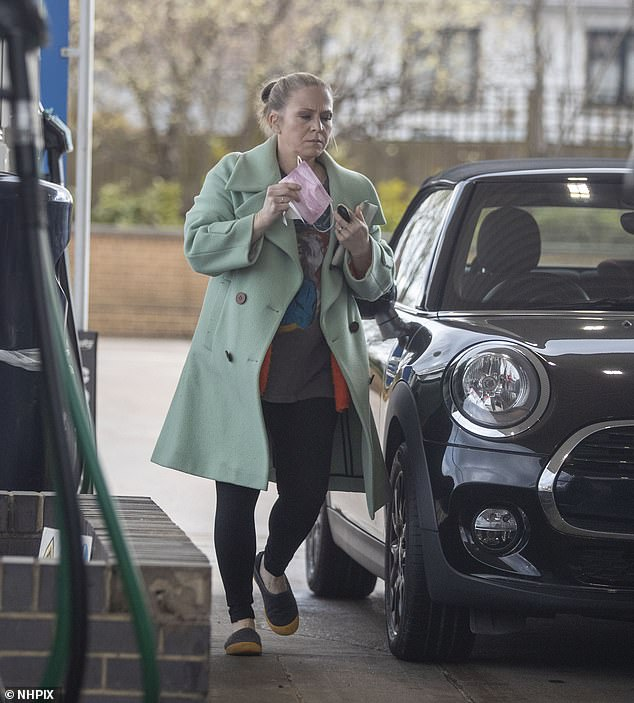 Staying safe: The pregnant star ensured to don a pink face mask as she headed into the shop to pay for the fuel