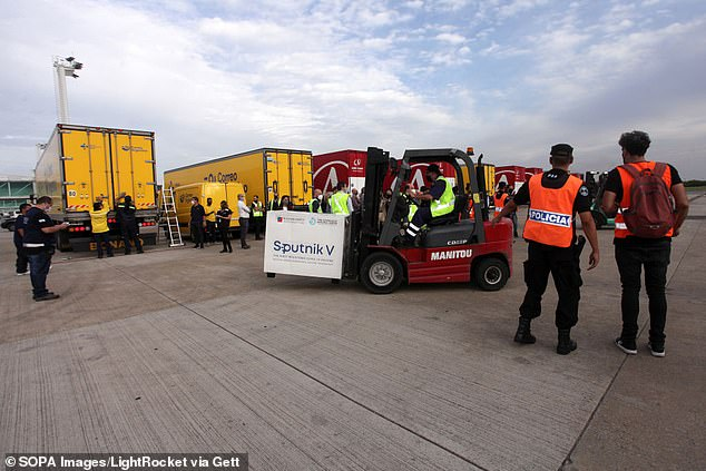 A container containing the Russian Sputnik V coronavirus vaccines is transported after it was loaded off an Aerolineas Argentinas flight at an airport in Argentina on Monday. More than 3 million people in Argentina have been vaccinated for the virus