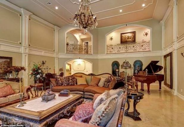 Live It Up - A large sumptuous living room includes an elegantly decorated fireplace and can be seen from the balconies on one of the upper levels
