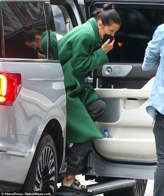 Face mask: While the fashionistas skipped the face masks while on set, Bella was seen carrying one as she got out of her car to stay safe as she arrived to work. To give her feet a break, the looker skipped the heels for a pair of black studded slides before getting in front of the camera.
