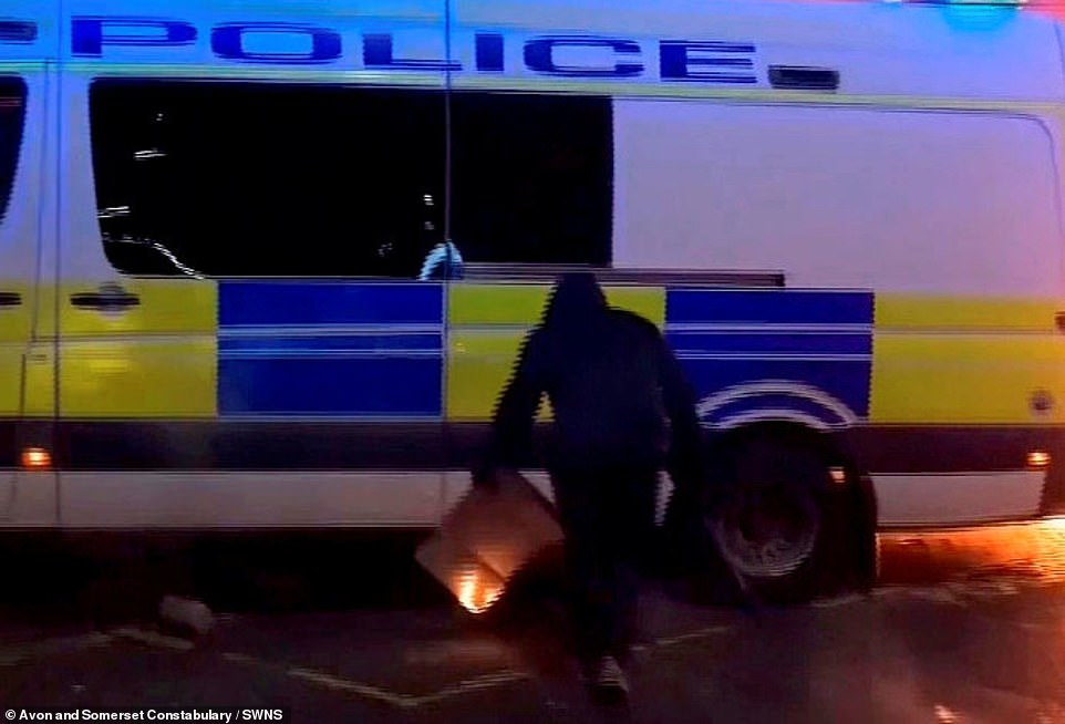 Newly released footage, taken during the violent 'Kill the Bill' disorder in the city on Sunday, shows the moment a lit item was placed under a police van while a police officer was inside