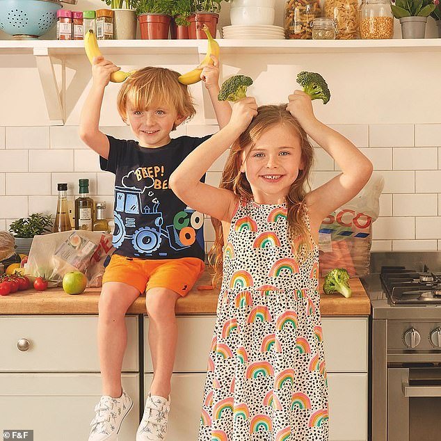 Sweet: Abbey Clancy's children have taken after their model mother as they took part in a new Tesco's F&F clothing campaign (Liberty, five, and Johnny, three, pictured)