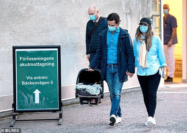 Princess Sofia, 36, cut a casual figure in a light blue shirt, black jeans and sneakers - and completed her look with a beige scarf and a casual black cap (pictured)