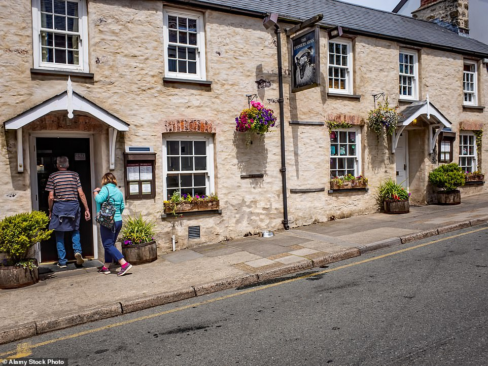 The Farmer's Arms in St David's, pictured, has views of St Davids Cathedral from a sheltered, suntrap patio