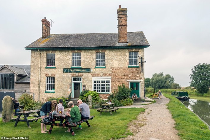 The Barge Inn in Honeystreet, Wiltshire. It is near an exquisite stretch of canal towpath patrolled by flotillas of mallards and moorhens