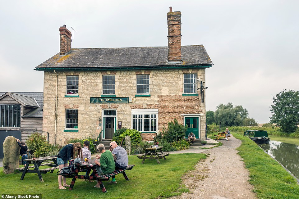 The Barge Inn in Honeystreet, Wiltshire. It is near anexquisite stretch of canal towpath patrolled by flotillas of mallards and moorhens