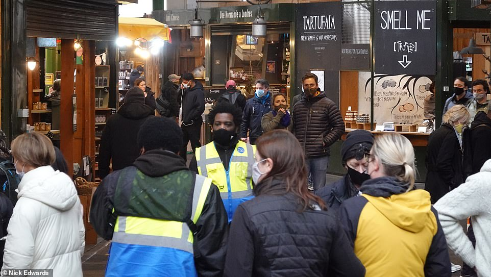 Borough Market in central London was heaving with mask-wearing punters browsing the stalls as they sipped from their cans and glasses