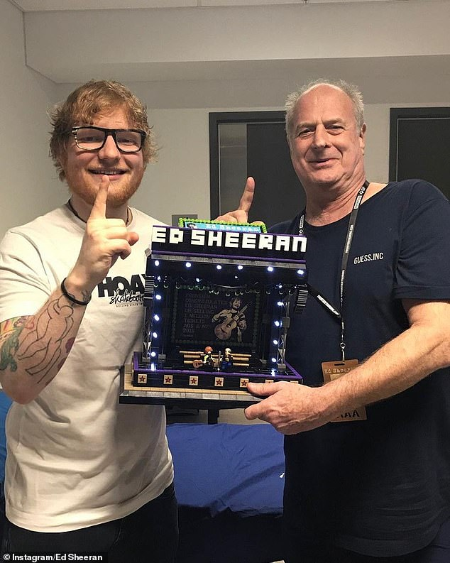 Great friends: Ed affectionately described Michael a 'father figure' who organised his record-breaking stadium tour of Australia back in 2018