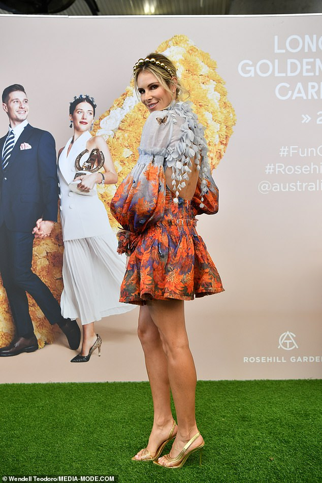 Divine:Candice's gorgeous frock featured a high ruffled neck, a cut-out at the back, billowing sleeves and a short A-line skirt