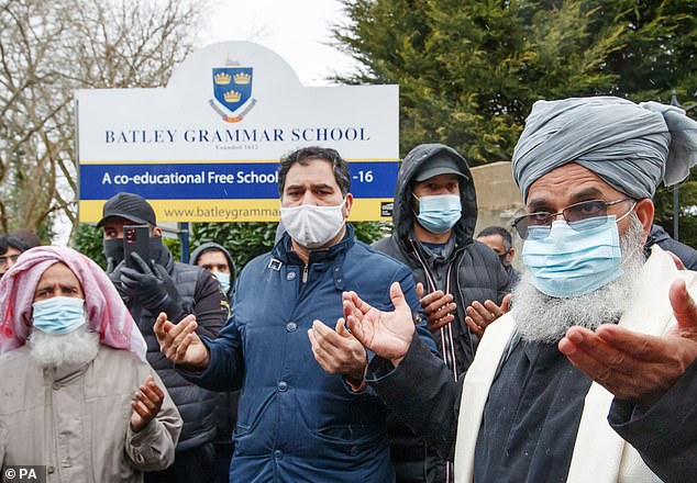 Protestors take part in a prayer outside the school. One protestorcalled on the entire British Muslim community to review the materials being taught in their children's schools