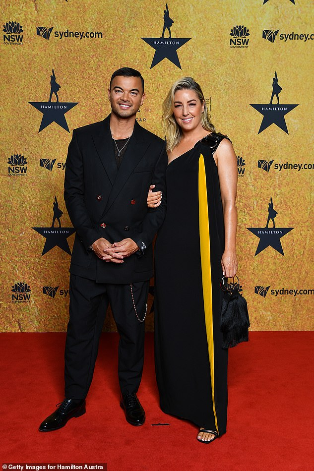 Trendy:Guy Sebastian and his wife Jules Sebastian looked sleek in black ensembles, with the singer, 39, choosing a black suit with a chic fob chain and patent dress shoes. Both pictured