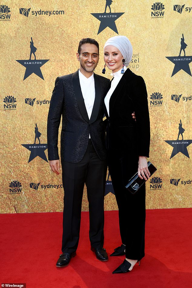 Well suited:Waleed Aly, 42, and his wife, Susan Carland, meanwhile made a stylish pair in matching black suits. both pictured