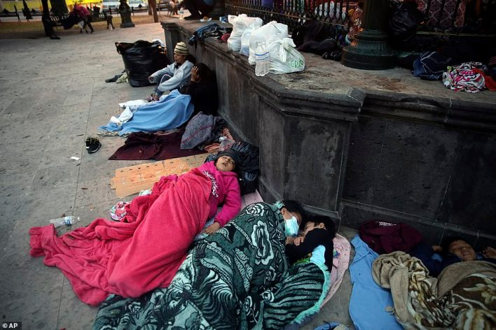 Migrants sleep under a gazebo at a park in the Mexican border city of Reynosa, Saturday