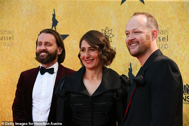 All smiles: The politician was all smiles as she fronted the red carpet at the glamorous event, alongside Hamilton's producer Michael Cassel (right) and Andrew