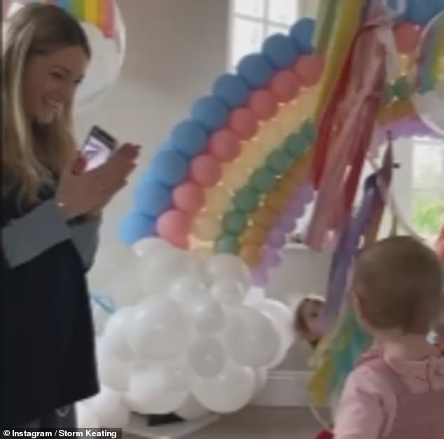 Happy birthday!Storm Keating revealed she celebrated her daughter Coco's first birthday at home as she was discharged from hospital after undergoing emergency spinal surgery