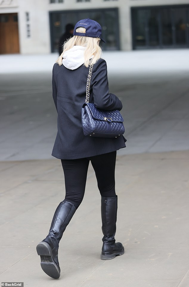Just the basics: The Strictly Come Dancing star carried her essentials in a navy quilted handbag with a gold chain strap over one shoulder