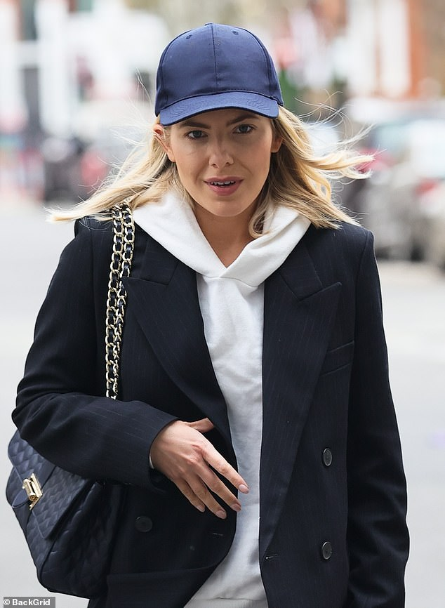 Office-casual: The former Saturdays singer, 33, went for both style and comfort in her work outfit which she topped off with a navy baseball cap