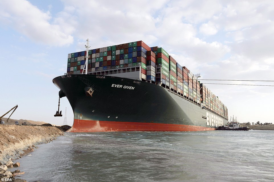 A tugboat near the Ever Given container ship which ran aground in the Suez Canal, Egypt, March 28, 2021