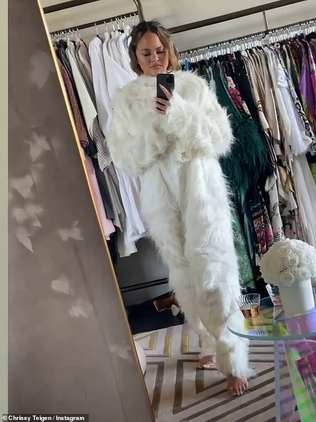Trying it on: Teigen's final Story post showed her trying on the Easter Bunny costume while spending a bit of alone time in her dressing room