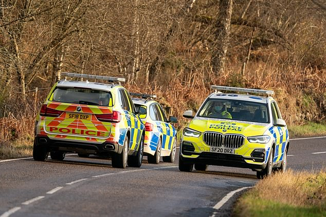 The vehicle was being driven near Alness by a 39-year-old man, who remains in hospital, along with a 15-year-old girl who is fighting for her life (pictured: Police at the scene)