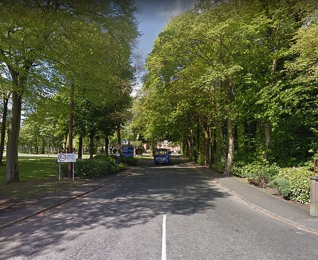 Police are hunting for two men after a 16-year-old girl was raped behind Dykebar Hospital in Paisley, Scotland, on March 20. Pictured: GV of wooded area behind Dykebar Hospital
