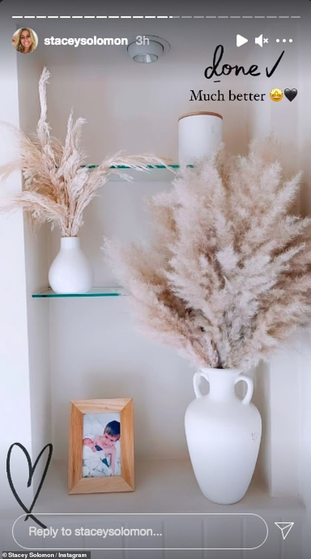 Personal:In the following slide she had added two white vases filled with pampas grass and an adorable framed snap of her sons