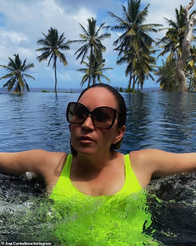 Dipping: Photographer Ana Carballosa also shared a photo of the artist from Joe Biden's inauguration on Sunday wearing a neon green one-piece swimsuit