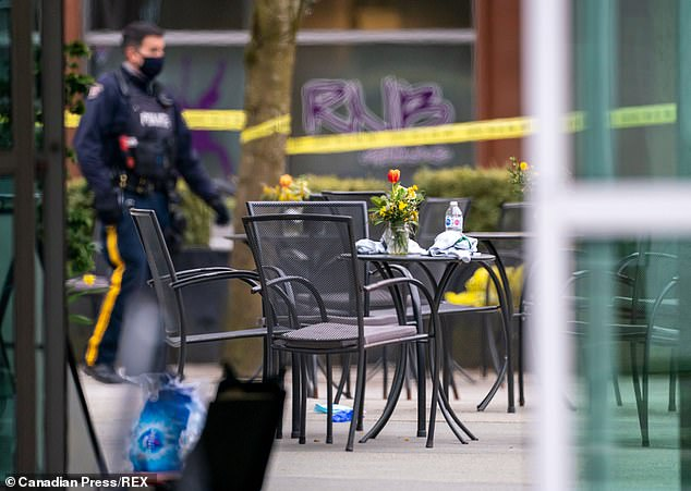 Police work the crime scene after the attack. Witnesses say the knifeman attacked at random, stabbing anyone who came into his path as he ran amok