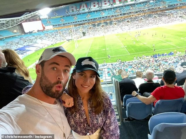 Fun night out! Chris Hemsworth (left) showed off his bulging muscles during a night at the rugby league in Sydney with wife Elsa Pataky (right) and their A-list friends on Friday