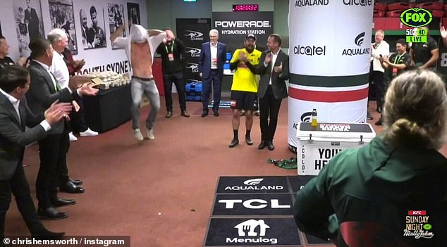 Cheering him on: After watching the game, the actor ripped off his shirt and did a bizarre dance in the locker room as he celebrated with the Rabbitohs players following their win against the Roosters