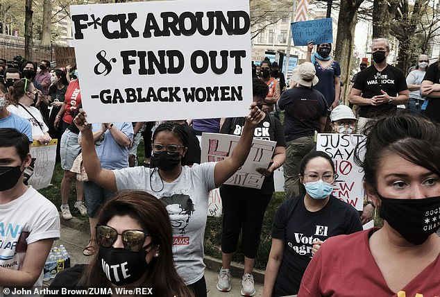 A group of demonstrators hold a rally outside of Atlanta City Hall on Saturday in support of Georgia State Representative Park Cannon, who was arrested on March 25.Cannon was arrested while knocking on the door of Governor Brian Kemp's office as he signed a sweeping voting rights bill into law
