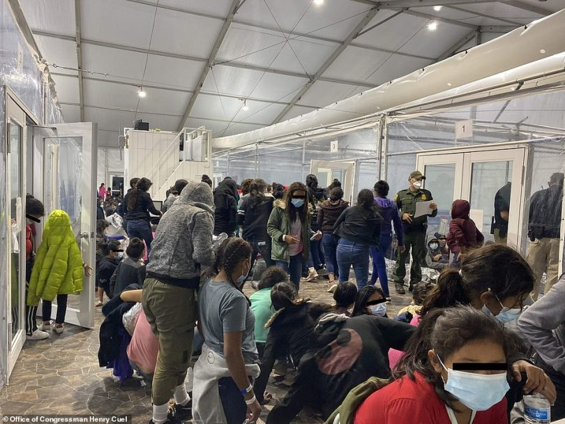 Migrants are seen inside of a US Customs and Border Protection temporary overflow facility in Donna, Texas on March 22