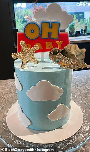 How cute!After finding out they were expecting a baby boy in November, the parents decorated their home in blue to celebrate - complete with Toy Story balloons, paper plates and a cake with the word 'Oh Baby' placed on top