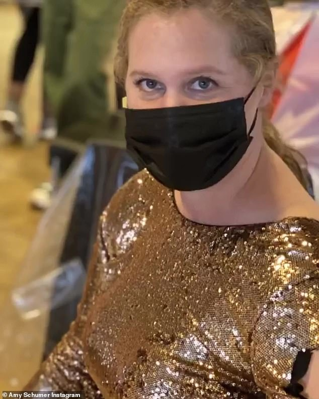 One shot down! Amy Schumer looked ready to walk down a red carpet in a gold sequined gown as she received her first dose of a COVID-19 vaccine on Sunday afternoon