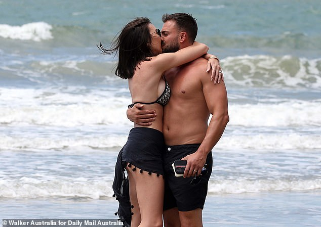 Adorable: The pair couldn't keep their hands off each other as they enjoyed the fresh sea air