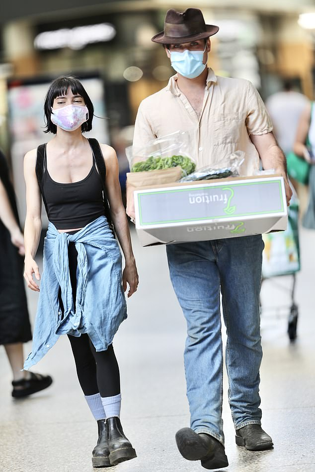Munchies: Lisa Origliasso made sure she was set for fresh food on Monday, ahead of Brisbane's new lockdown. The Veronicas singer, 36, was accompanied by her husband Logan Huffman, with the pair picking up fresh food at Gasworks Plaza. Both pictured