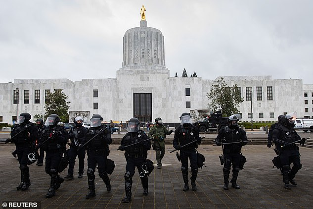 "Police are seen as Oregon State Police and the Salem Police officers declared an ""unlawful assembly"" during an anti-fascist rally in Salem"