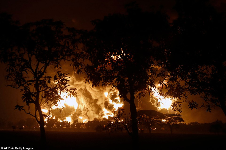 Flames tear into the skies above the Balongan oil refinery in Indonesia following a massive explosion at the site. The cause of the explosion is not yet known but it is believed to have taken place during an eletrical storm