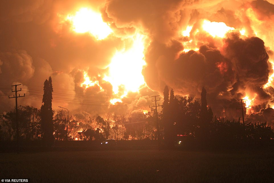 The skies above an Indonesian village erupted into a raging inferno this morning following an explosion at the Balongan refinery in West Java