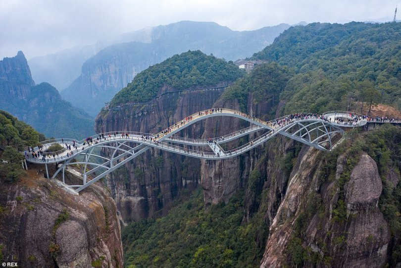 The Ruyi Bridge, pictured, is adouble-deck glass bridge in China with a mind-boggling design that is just too scary for some people