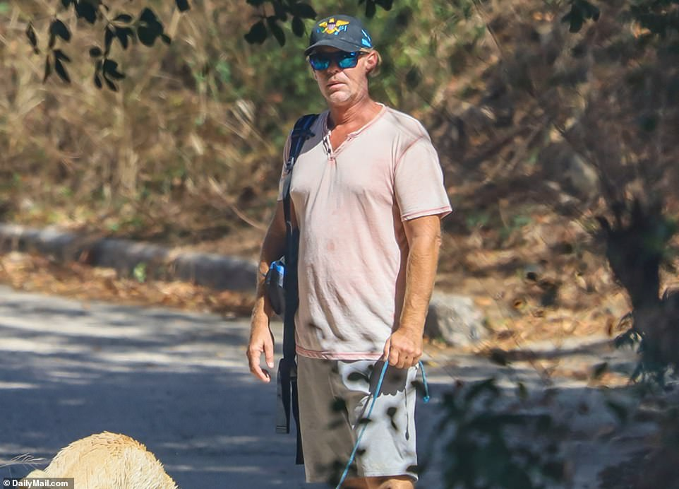 Ryan Bane refused to discuss his girlfriend Sarm Heslop's disappearance last week as DailyMail.com confronted him on a secluded beach in the US Virgin Islands. He's pictured on Wednesday on shore