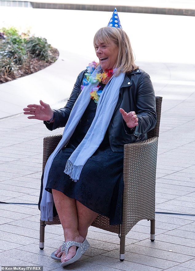 Festive vibe: Linda Robson got into the spirit of things, wearing a festive paper hat and lei