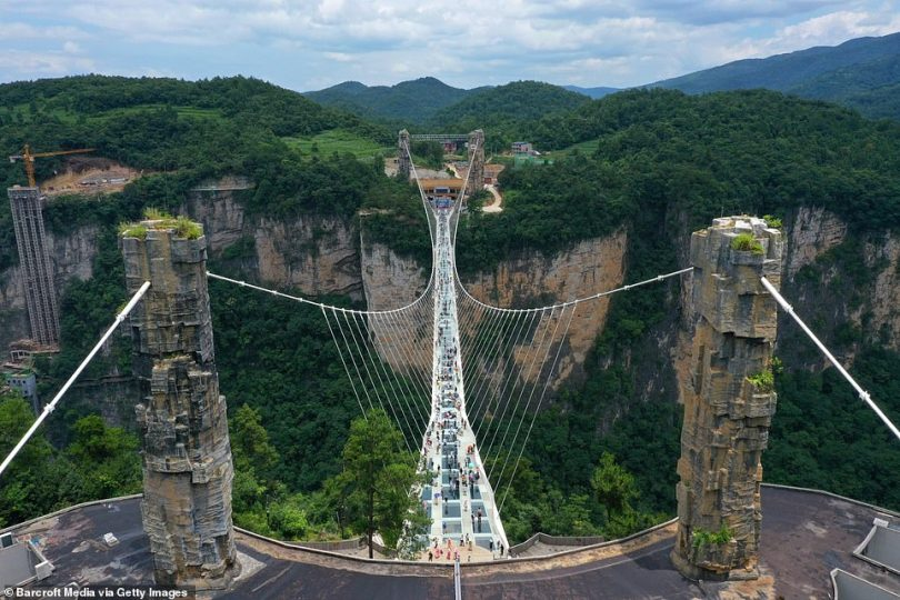 The Zhangjiajie Glass Bridge inChina's central Hunan province. It is suspended300 metres (984ft) above a sheer drop