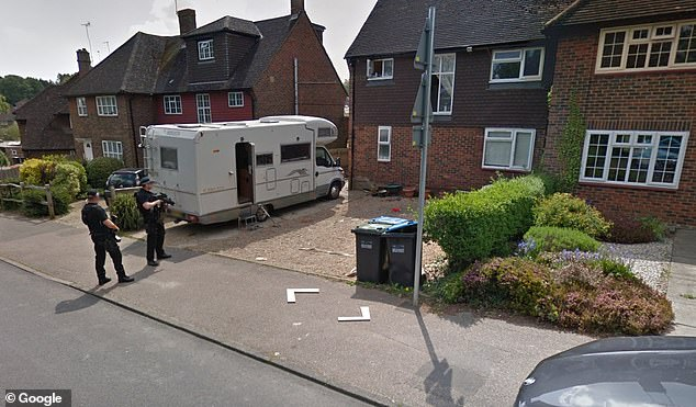 Eager property hunters spotted spotted armed police breaking up a fight outside a £375,000 home in West Sussex on Google's Street View (pictured)