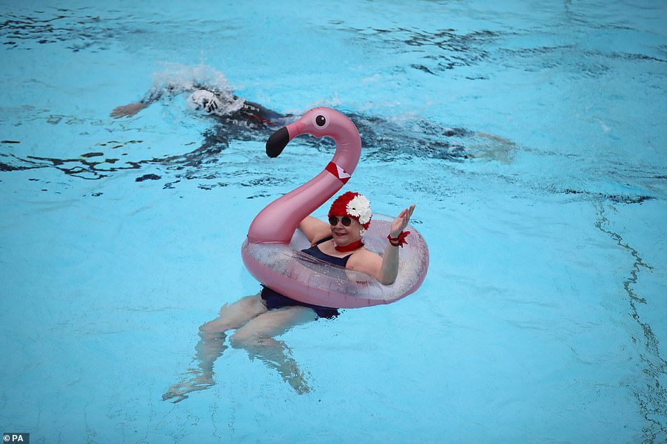 Nicole Foster enjoyed her first swim for months in a rubber flamingo at Hillingdon Lido in Uxbridge, west London
