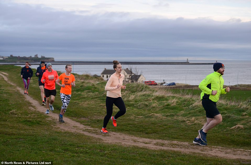 Members of the Run Eat Sleep running group enjoy an early morning run across South Shields seafront today