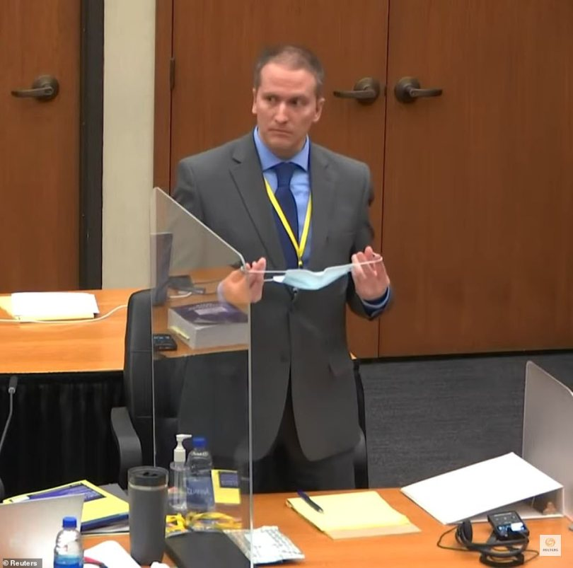 Chauvin is seen above in court on Monday for the start of opening arguments.Williams strayed into contentious territory when he gave the opinion that Chauvin was killing Floyd by 'shimmying' or adjusting his position on the dying man's neck