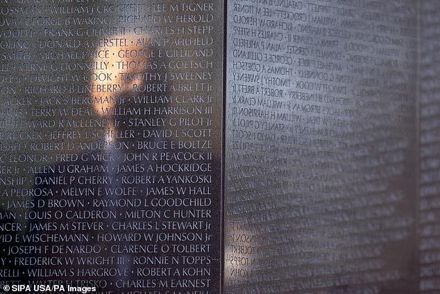 A reflection of President Joe Biden is seen from the Vietnam War Memorial in Washington, D.C., Monday